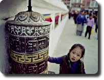 prayer wheel and girl